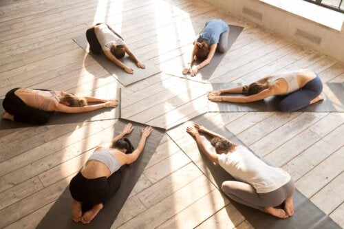 A group doing the child pose.