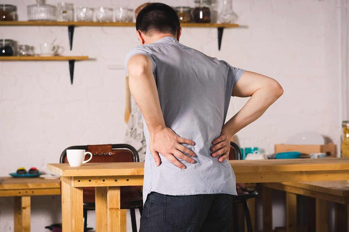 A man suffering from back pain.