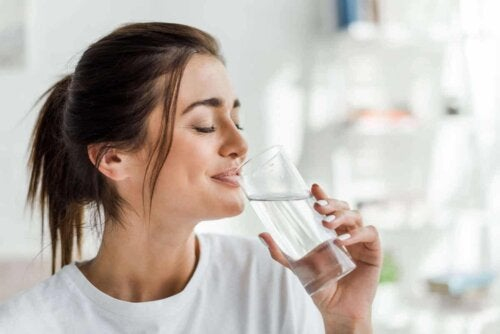 A woman drinking water.