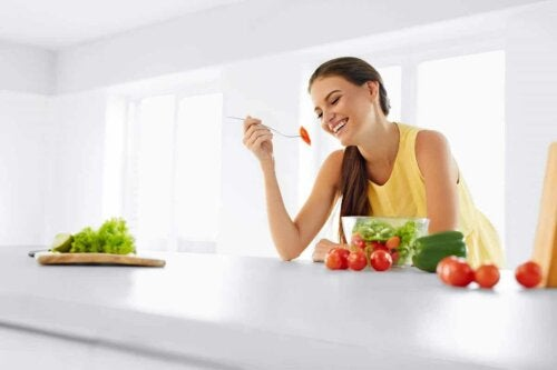A woman eating greens.