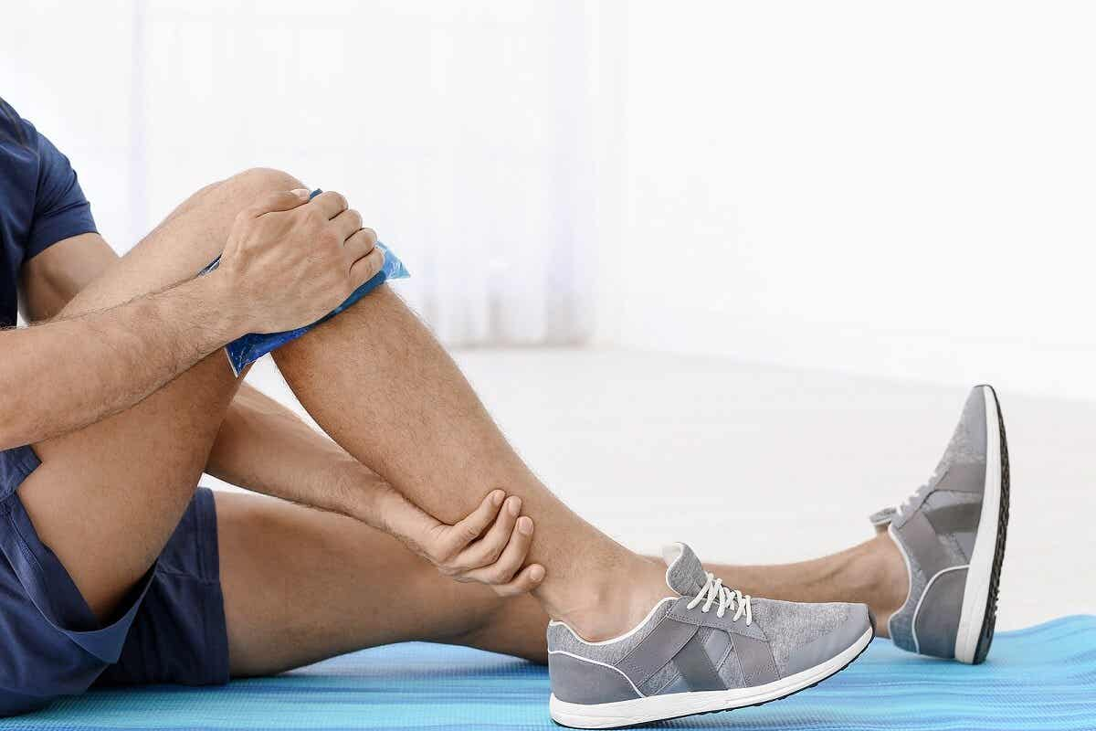 Applying cold on leg.