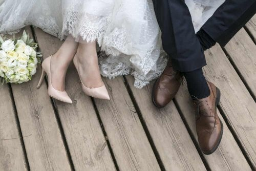 The shoes of a bride and groom.