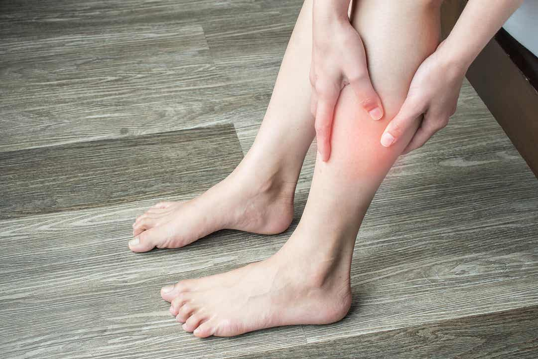 A woman with a sore calf muscle.