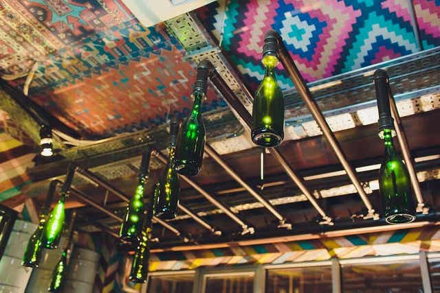 Lampshades made out of old green bottles.