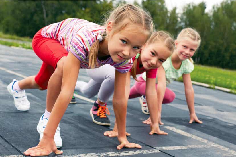 Children preparing to run a race.