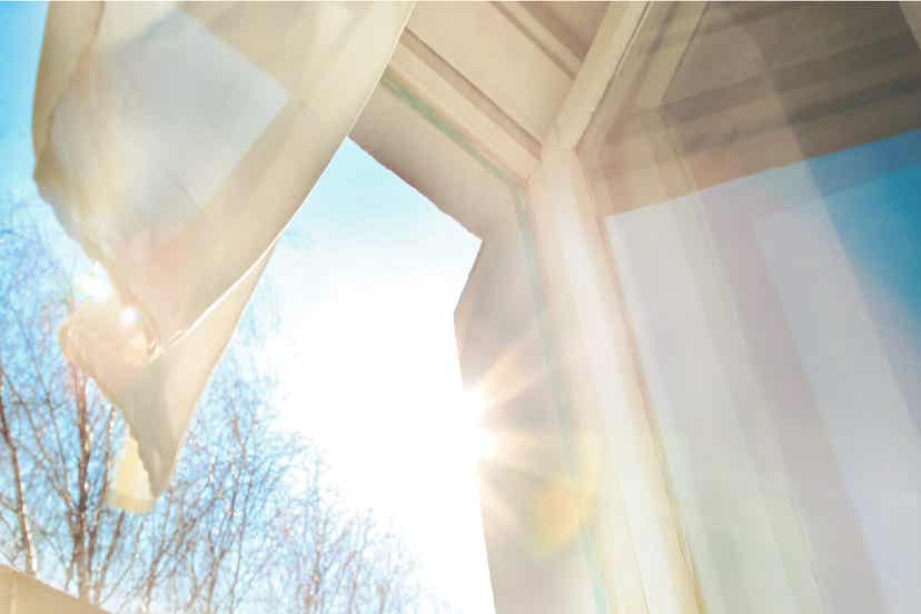 The sun shining down on an open window in winter.