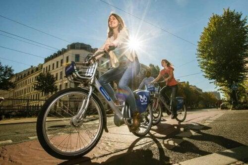 Three people bicycling.