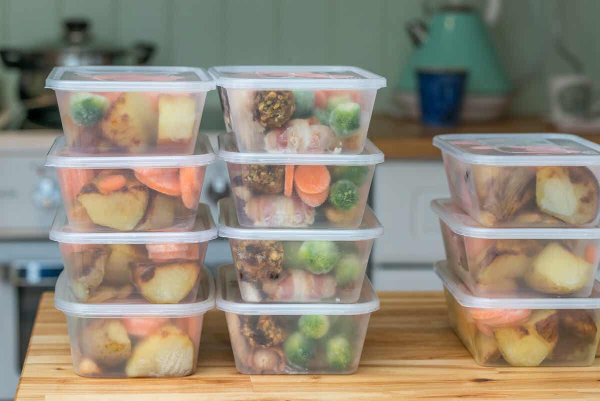 Healthy food stacked in plastic boxes.