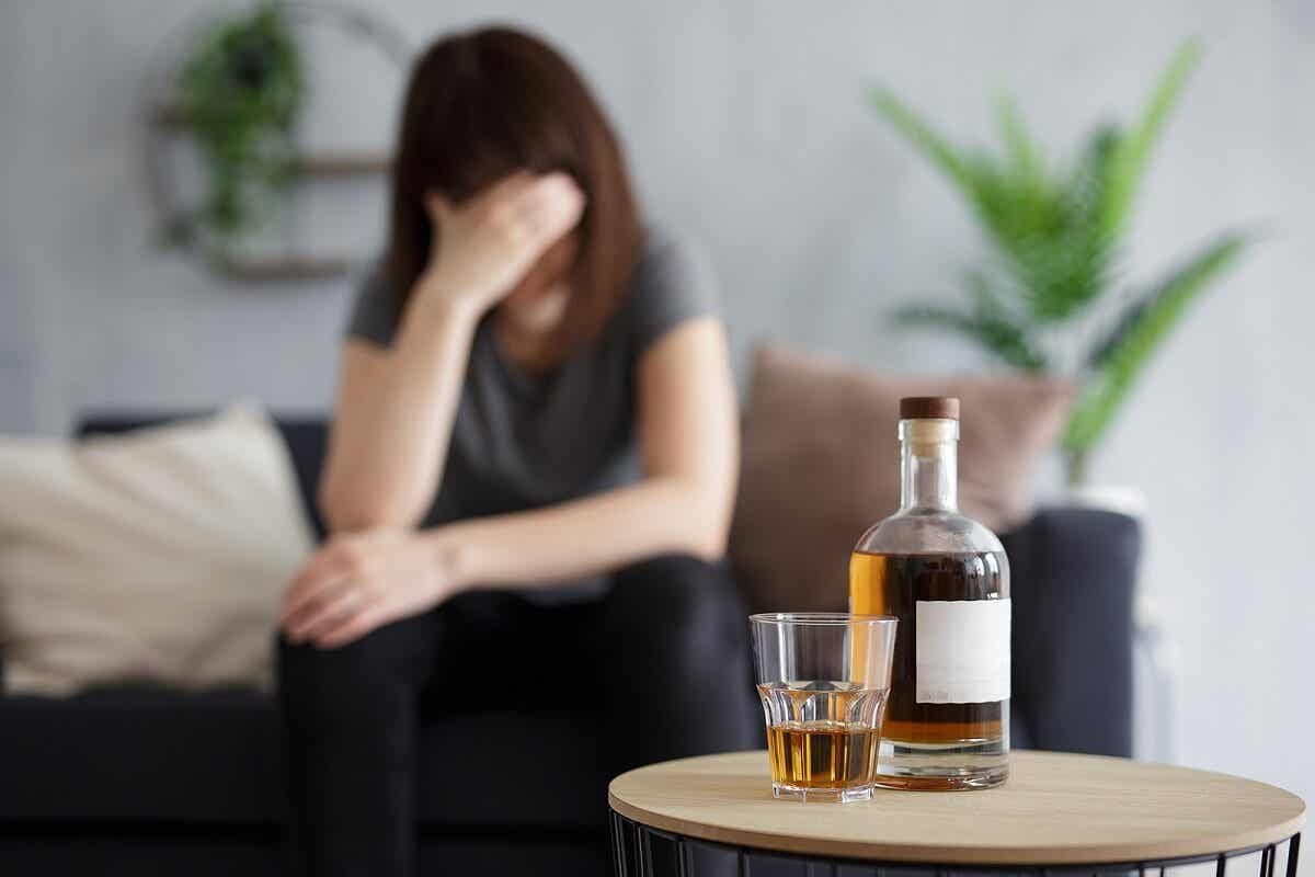 sad person with alcohol