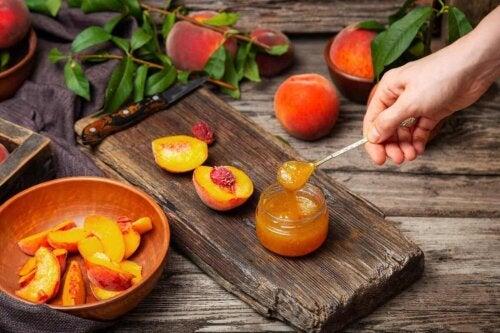 A person making homemade peach jam.