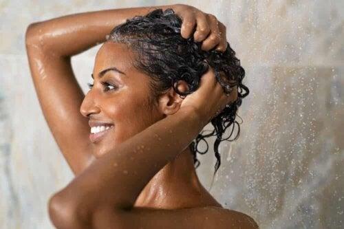 A woman washing her hair.