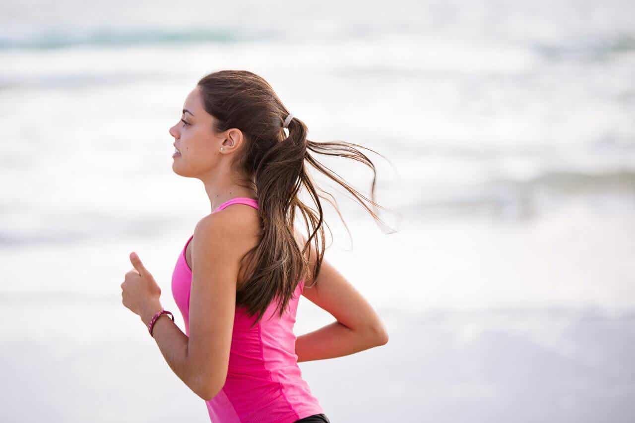 A woman running along the beach.
