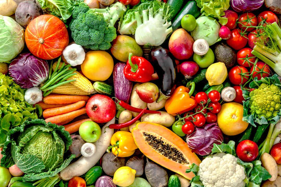 A variety of fruits and vegetables of all different shapes and sizes.