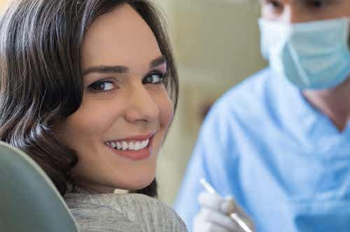 A woman getting her teeth cleaned at the dentist.