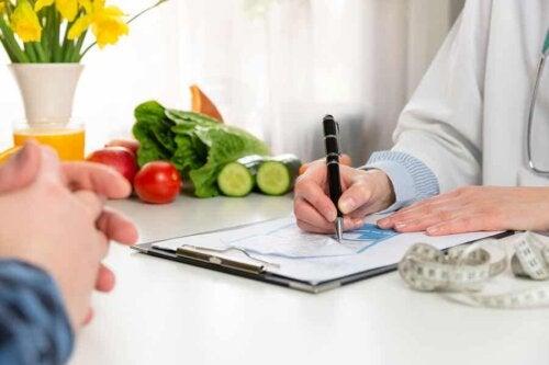 A doctor writing a prescription.