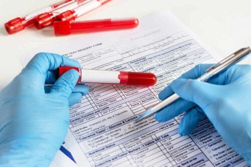 A lab technician filling out a form.