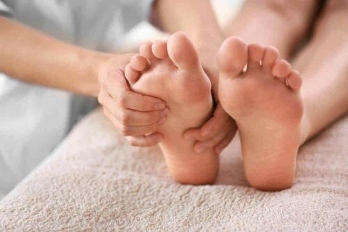A person massaging someone's feet.