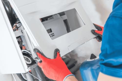 A person repairing an appliance.