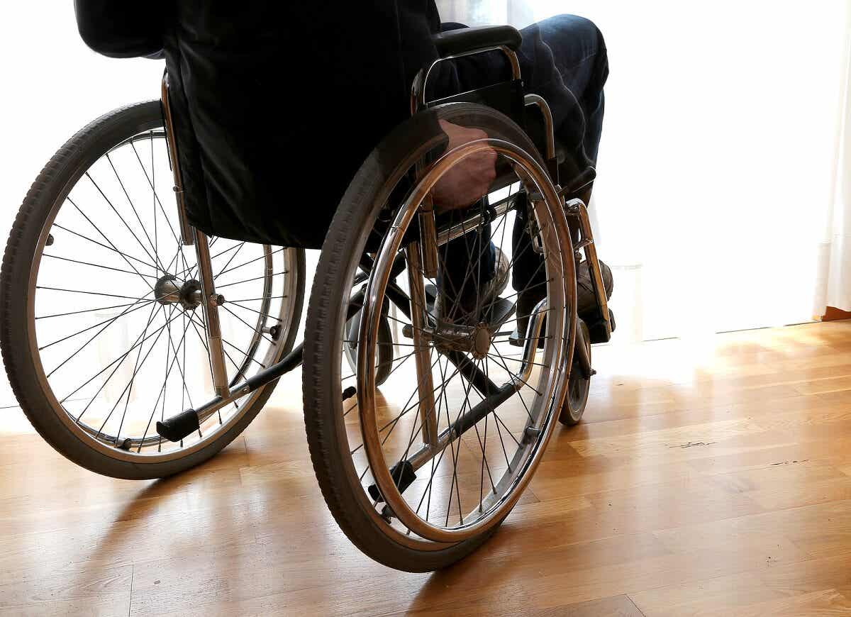 A person with MS in a wheelchair.