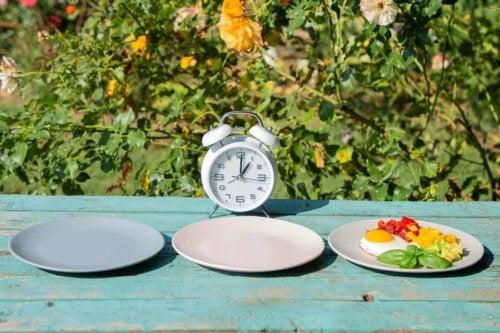 Three plates and a clock.